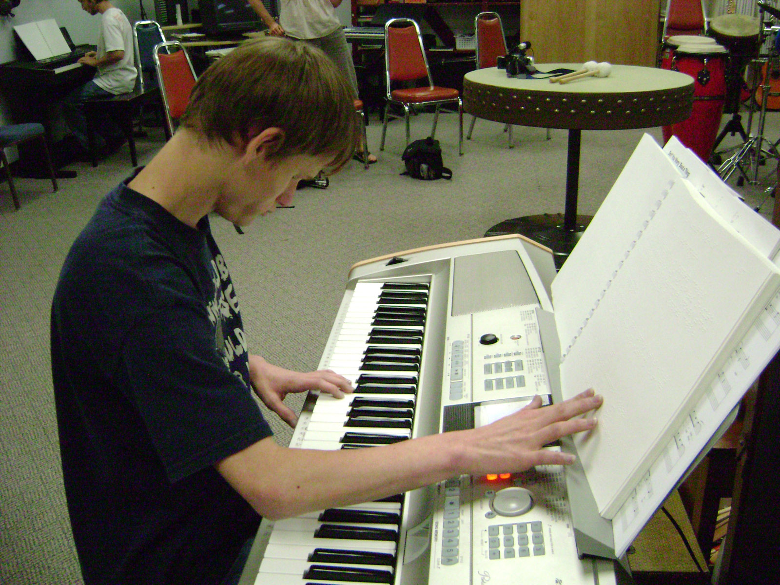 playing the piano using braille music notation